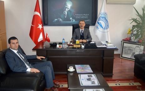 Kaymakamı Murat Beşikci, Başkan Kurukız'ı makamında ziyaret etti.